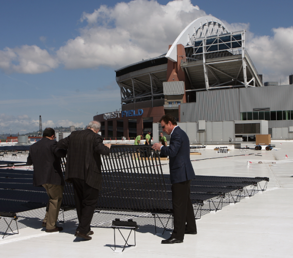 Seahawks execs inspect new solar panels at the Qwest Field Events Center