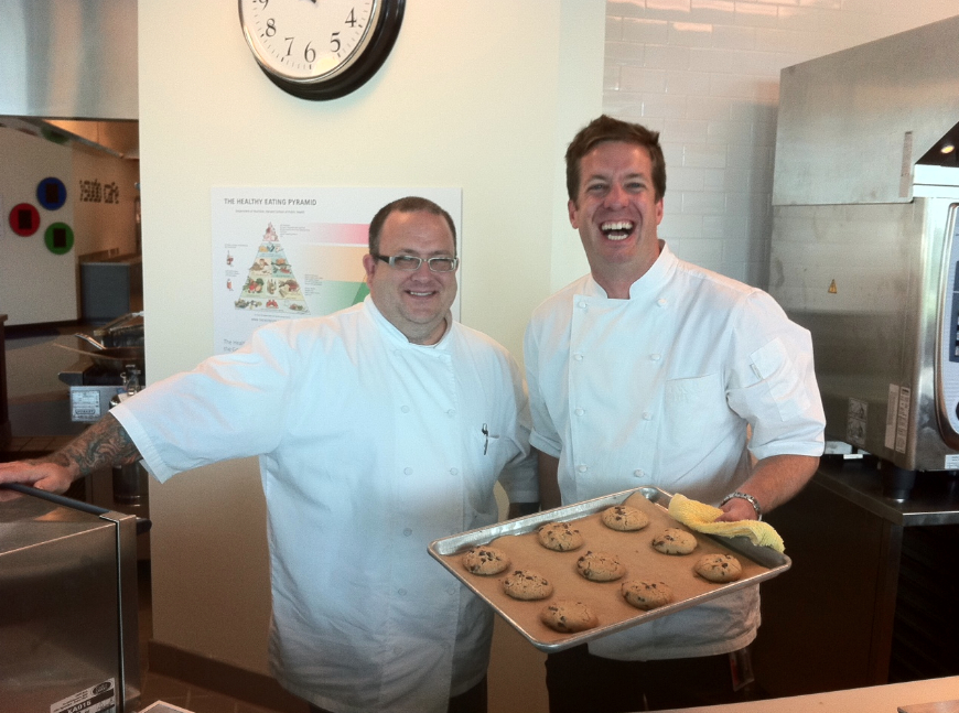 Google Chef Jason Wilson, right, holds some chocolate chip cookies