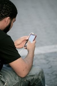 Mobile phone user (Flickr photo via Alex Proimos)