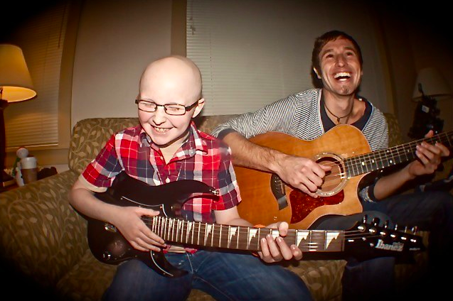Baydon Hutchison, 11, and Melodic Caring Project founder Levi Ware jam at the Ronald McDonald House in Seattle. (Photo: Melodic Caring Project)