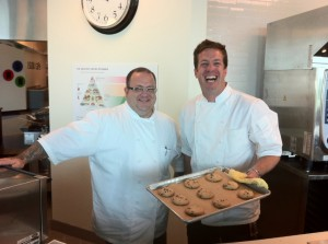 Google Chef Jason Wilson, right, holds some chocolate chip cookies at the company's Kirkland campus.
