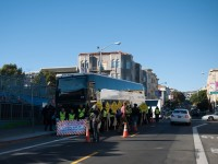 Protestors block a shuttle bus transporting Google employees in San Francisco (Credit: cjmartin on Flickr)