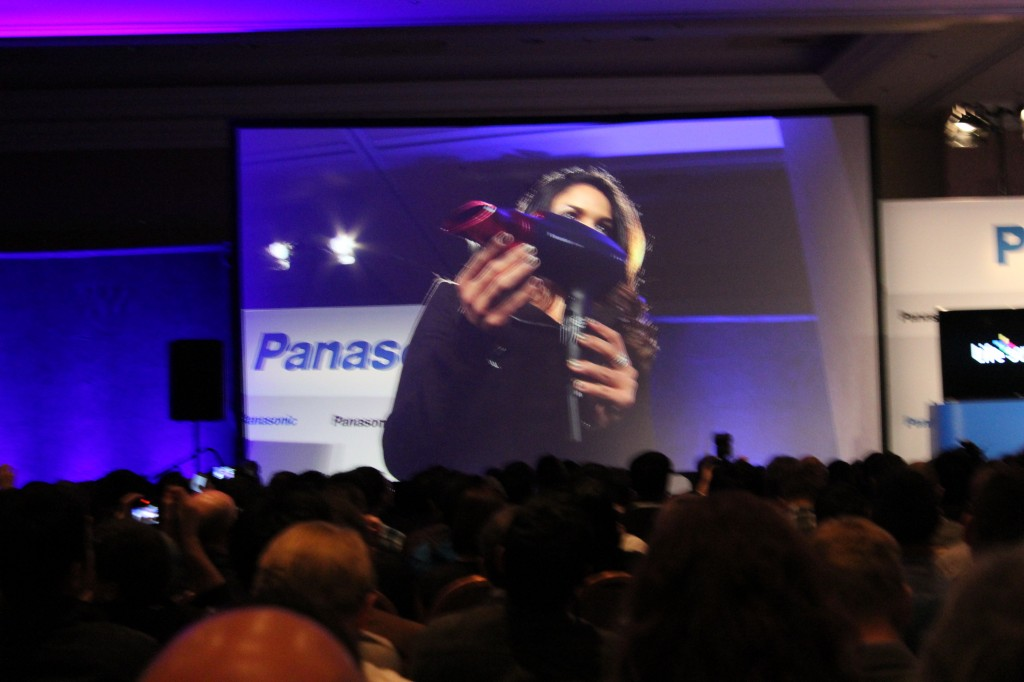 A Panasonic rep shows off the company's new hairdryer at its CES press event on Monday morning.