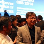 Samsung CEO and Chairman Kwon Oh Hyun (right) and Michelin-starred chef Michel Troisgros (left) speak after Samsung's press event at CES 2014.