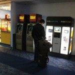 "A traveler checks out Amazon's new ""Kindle' Kiosk"" at the Las Vegas airport."