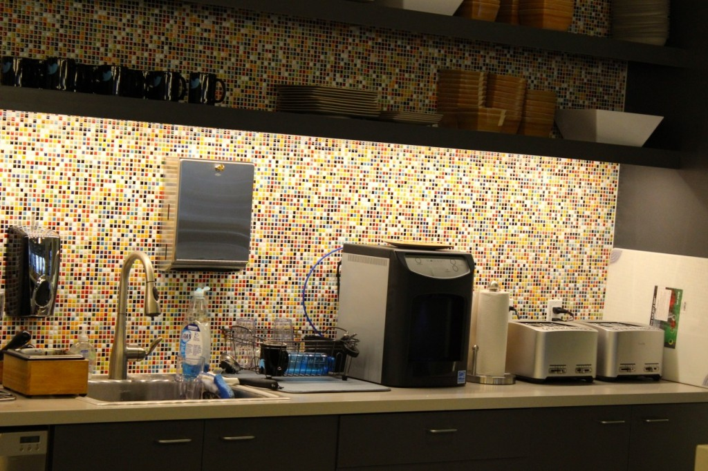 The kitchen wallpaper inside Twitter's new Seattle office pays homage to the famous gum wall at Pike Place Market.