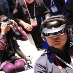 A CES attendee tries on Sony's personal virtual reality headset.