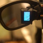 nnovega, a Seattle-area company that has been getting lots of attention for its augmented-reality glasses technology, showed off a new prototype here that uses a small panel similar to Google Glass,