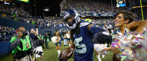 Richard Sherman celebrates after an interception. Photo via RichardSherman25.com