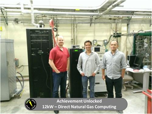 Three men standing in front of a server rack.