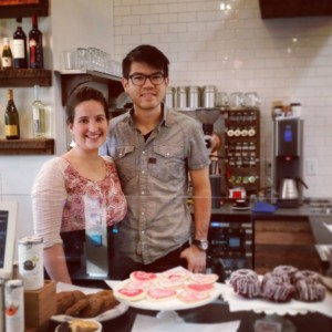 Danielle Hulton (left) and David Hulton (right) standing in front of pastries in the cafe at Ada's Technical Books.