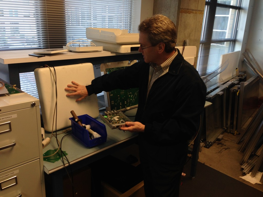 William Colleran shows off a test version of its xArray RFID reader.