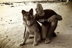 Kushal and his dog, Simba, relax in Laguna Beach.