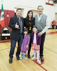 DoubleDown Interactive president Glenn Walcott (left), his wife Michelle and daughters Lauren and Amanda pose with former Mexico president Vicente Fox at Newport High School.