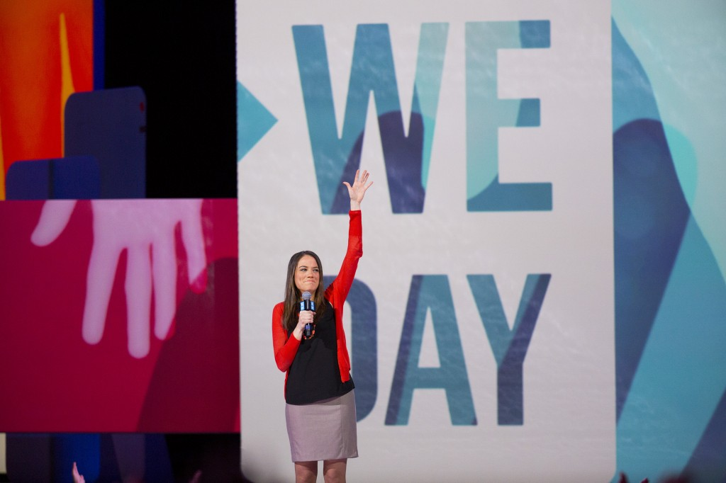 Madrona Venture Group Principal Julie Sandler speaks at We Day Seattle 2014 in front of 15,000 students at Key Arena. Photo courtesy of We Day.