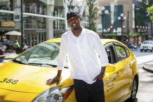 Salah Mohamed, a 14-year Seattle taxi veteran, says he doesn't mind competition from companies like Uber but wants a level-playing field for all transportation providers. Photo courtesy of Mohamed.