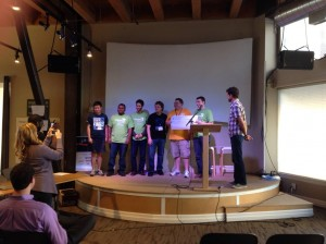 The team from Ikos, an app built to help streamline the process of getting housing for homeless people, receive their people's choice award Sunday at the Code for the Kingdom hackathon.