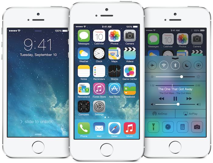 Three white iPhone 5S handsets displaying iOS 7