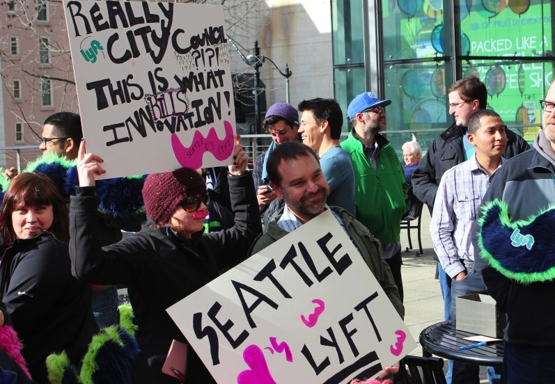Lyft supporters gather at a City Hall rally in February.