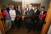 City Council President Hank Margeson cuts the ribbon to inaugurate Sonata US Office and Delivery Center-Redmond, accompanied by Sonata MD & CEO Srikar Reddy