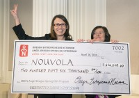 Nouvola CEO and co-founder Paola Moretto with her $250,000 prize. Photo courtesy of OEN.