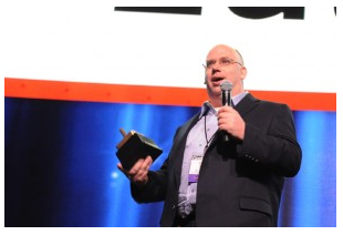 "Darrell Cavens accepts the award for ""Next Tech Titan"" at last year's GeekWire Awards."