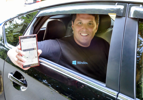 Terry Myerson shows off the Uber app on a Windows Phone device.