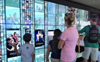 Visitors check out the Needle's new 20-foot by 8-foot 'Skypad' interactive screen. (Photo: Mónica Guzmán)