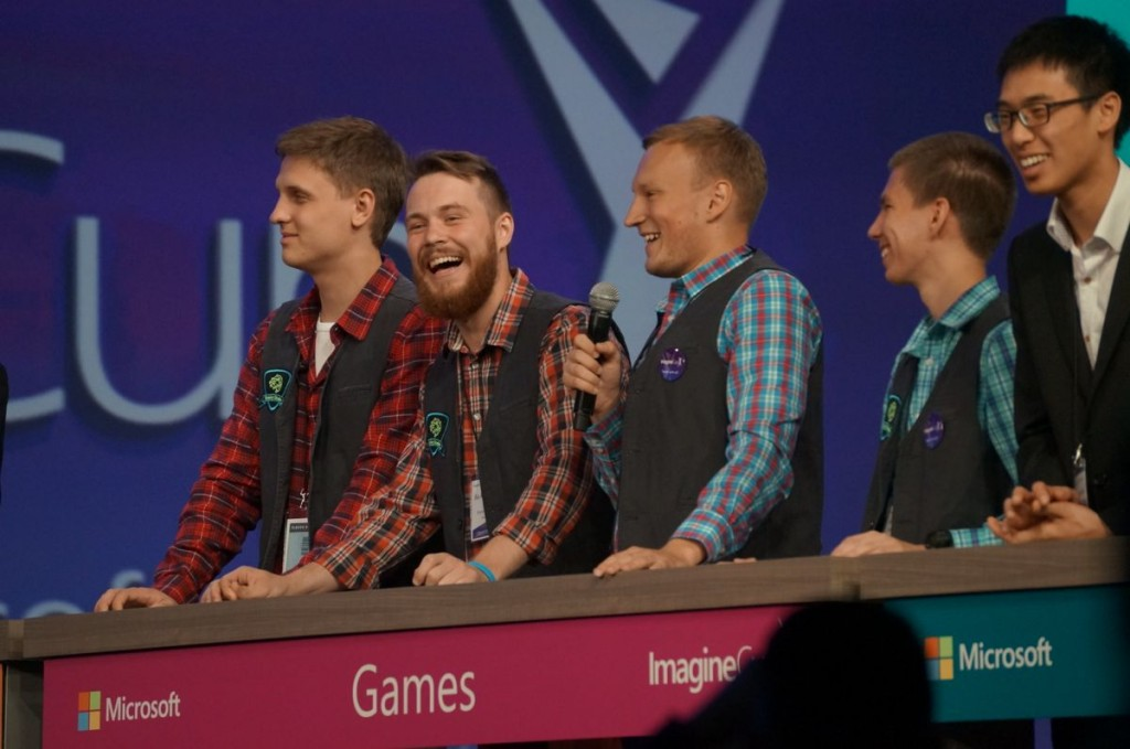 Members of the Brainy Studio team answer questions during the final round of the 2014 Microsoft Imagine Cup.