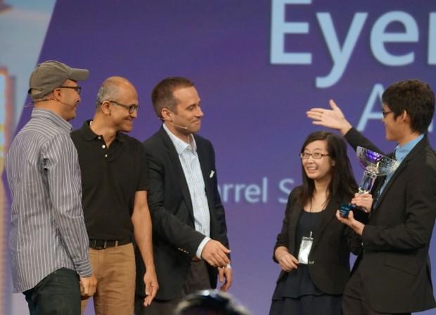 Hadi Partovi of Code.org, Microsoft CEO Satya Nadella, and Reddit's Erik Martin congratulate Jennifer Tang and Jarrel Seah of Australia, winners of the 2014 Imagine Cup.