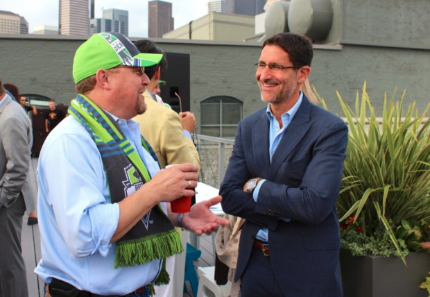 Silicon Valley Bank's Geir Hansen chats with Sounders FC owner Adrian Hanauer at Sounders Day