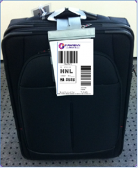 A suitcase bearing one of Hawaiian Airlines's Tag@Home tags