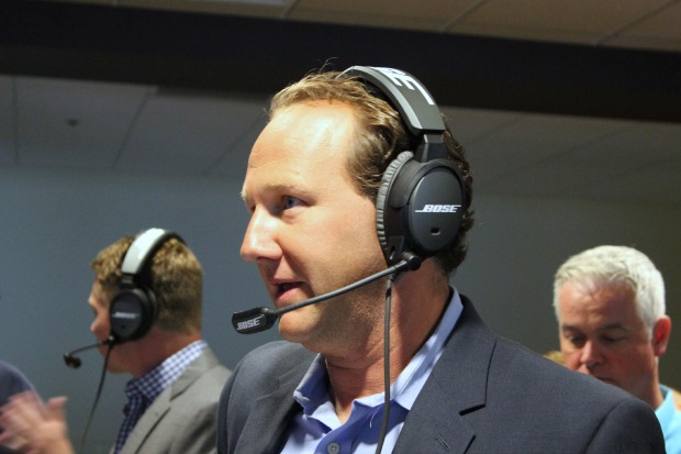 KING5's Chris Egan tests out Bose's headsets for NFL head coaches at an event last year.