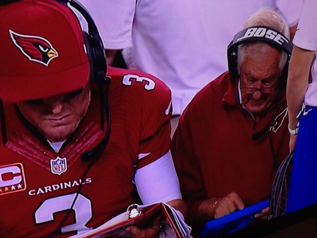 Carson Palmer getting instruction from Tom Moore who is using a Surface Pro 2, not an iPad.