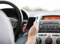 Cell phone use in the car is causing all sorts of distractions. Photo via Shutterstock