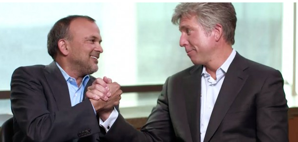 Steve Singh, left, of Concur celebrates with SAP CEO Bill McDermott.