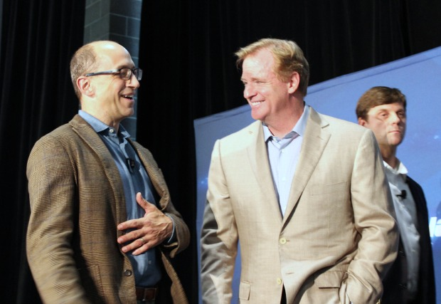 Twitter CEO Dick Costolo and NFL Commissioner Roger Goodell chat at an NFL event in Seattle on Wednesday.