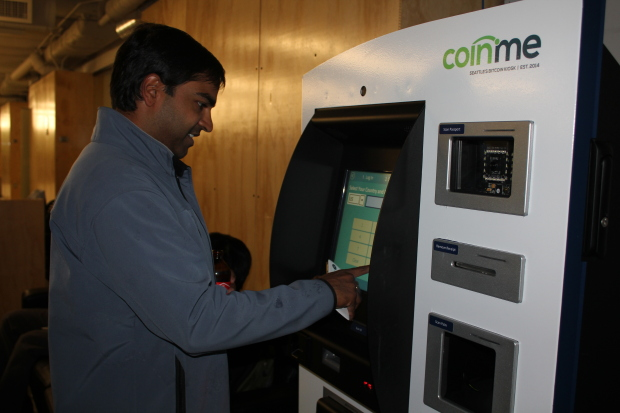 Photo1: Vijay Boyapati, (CQ) a member Seattle Bitcoin Meetup, uses the University of Washington's first Bitcoin ATM. Coinme, which manages Seattle's Bitcoin ATMs, hopes Startup Hall will encourage student interest in the currency. Credit: Ashley Stewart