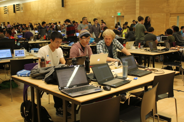 University of Washington students Theodore Chin, Brian Park and Ben Schiffler plan projects before the start of the first-ever DubHacks. Photo by Ashley Stewart.