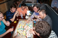 Game players break out Ticket to Ride at last year's GeekWire Game Night.