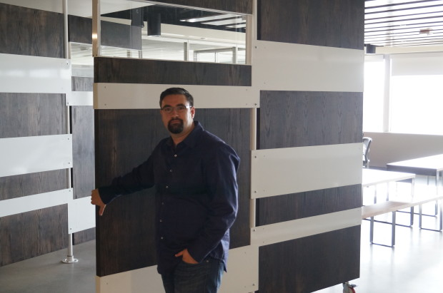 Jared Wray shows office the  moveable doors in the company's lunch room.