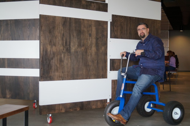 Jared Wray on a giant tricycle inside CenturyLink's new cloud center.