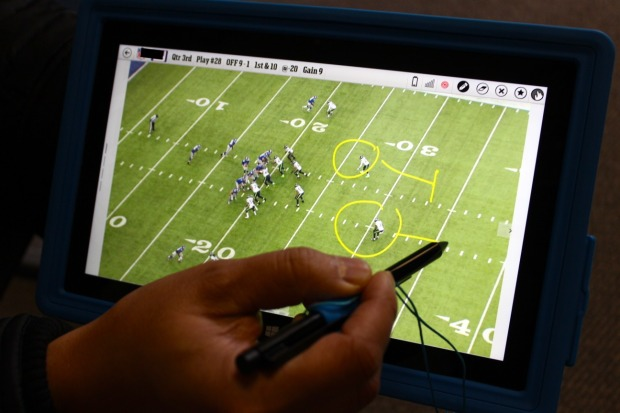 The use of the Surface in the NFL was designed to replace printed paper black and white images of plays. (GeekWire file)