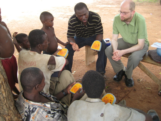 Literacy Bridge Country Director Andy Bayor and founder Cliff Schmidt introduce the Talking Book to a Ghanaian village.
