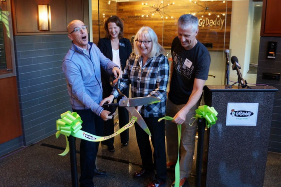 GoDaddy CEO Blake Irving, left, cuts the ribbon at the company's new engineering office with Kirkland CIty Councilmember Amy Walen, Mayor Joan McBride and GoDaddy chief architect Arnold Blinn.