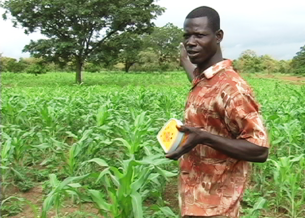 A Ghanaian farmer explains how he uses the Talking Book. Photos via Literacy Bridge.