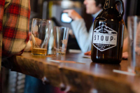 A growler on a table at Stoup brewery in Seattle