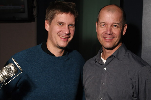 GeekWire co-founder John Cook, left, with his brother Dave Cook in the KIRO Radio studios. (Erynn Rose Photo)