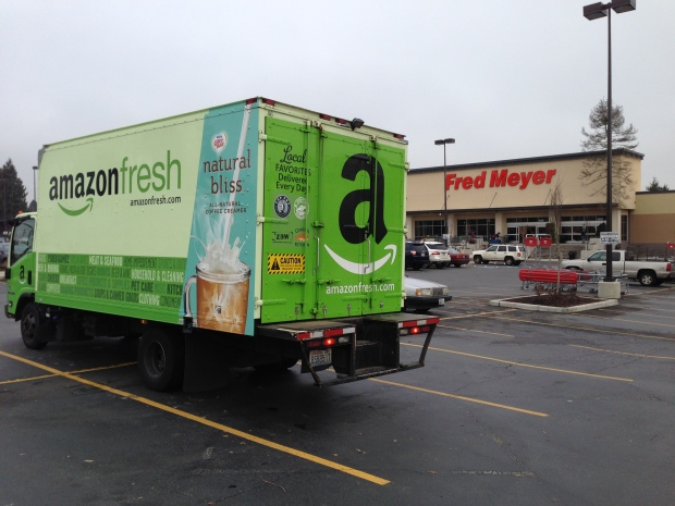 An Amazon Fresh truck idles outside Fred Meyer in Seattle's Greenwood neighborhood.