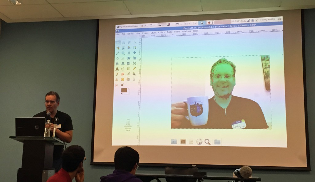 Henry Kroll demonstrates facial redaction of his own photo in real time, using open source software. Photos Bill Schrier